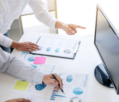 bookkeeper and business man calculating something over computer