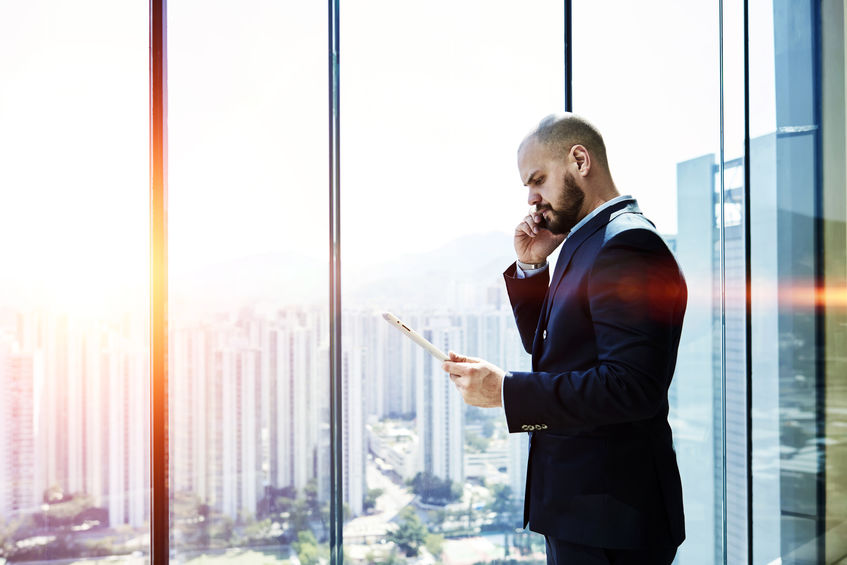 Angry businessman is calling via mobile phone to client