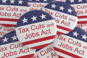 Accounting for Tax Cuts and Jobs Act Buttons With US Flag