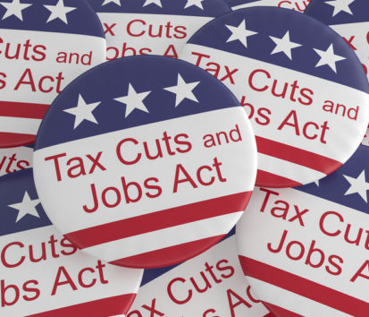 Pile of Tax Cuts and Jobs Act Buttons With US Flag